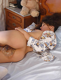 Curly brunette toying her pussy with a double dildo, also having a self fisting