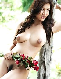 Busty Thai rose Lydia Nitta strips and bares big breasts